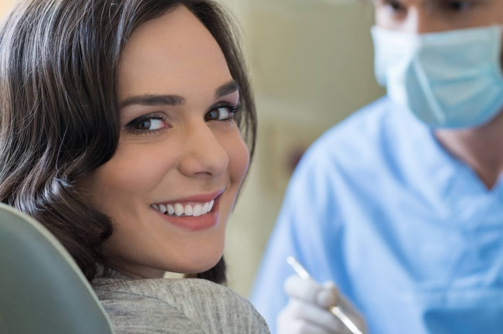 Dentist in Underwood conducting a consultation with a client